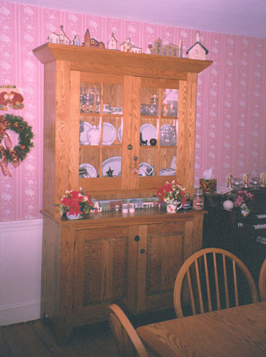18th Century Setback Cupboard, Cheryl's Church collection on top.